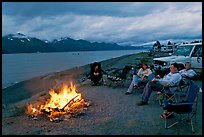 Sitting by campfire at midnight, waterfront campground. Seward, Alaska, USA ( color)