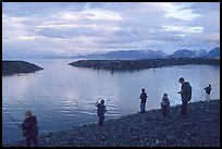 Fishing for salmon in the Spit's Fishing Hole. Homer, Alaska, USA ( color)