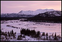Frozen river and mountains at sunset. Alaska, USA ( color)