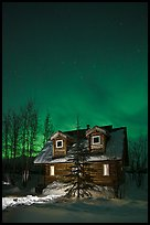 Cabin at night with Northern Lights. Wiseman, Alaska, USA (color)