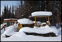Machinery covered in snow. Wiseman, Alaska, USA ( color)
