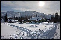 Backlit view of snow-covered village. Wiseman, Alaska, USA ( color)