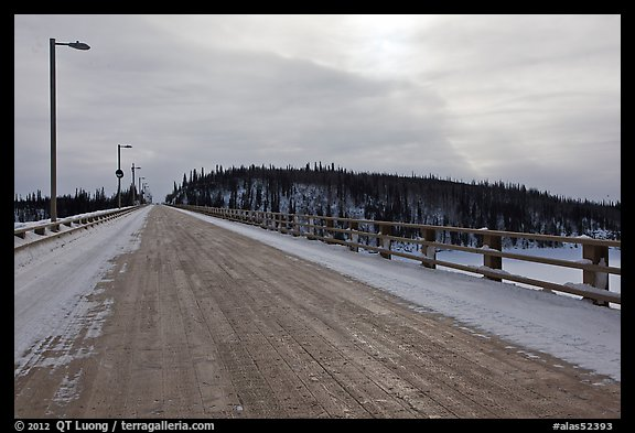 Long wooden bridge across Yukon River. Alaska, USA (color)
