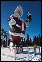 Santa Claus statue surrounded by barbed wire. North Pole, Alaska, USA ( color)