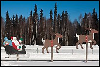 Santa Claus and reinder cut-out in winter. North Pole, Alaska, USA ( color)