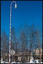 Street light decorated with a candy cane motif. North Pole, Alaska, USA (color)