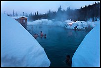 Soaking in natural hot pool surrounded by snow. Chena Hot Springs, Alaska, USA ( color)