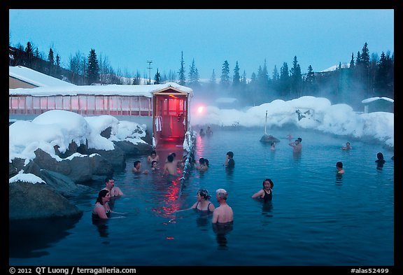 People soaking in outdoor hot springs pool in winter. Chena Hot Springs, Alaska, USA (color)