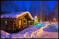 Path in snow and cabins at night. Chena Hot Springs, Alaska, USA ( color)