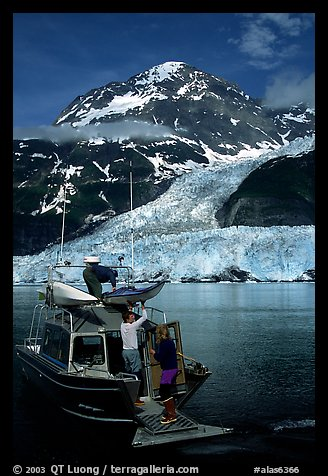Kayakers unloading from the water taxi at Black Sand Beach. Prince William Sound, Alaska, USA