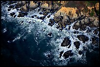 Aerial view of surf and rock. San Mateo County, California, USA