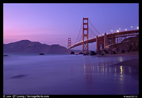 Golden Gage bridge at dusk, reflected in wet sand at East Baker Beach. San Francisco, California, USA (color)