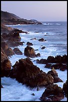 Coastline with pointed rocks and surf, sunset, Garapata State Park. Big Sur, California, USA