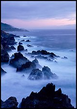 Rocks and surf near Rocky Cny Bridge, Garapata State Park, dusk. Big Sur, California, USA (color)
