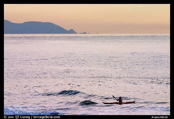 Sea kayaker, Rodeo Beach, sunset. California, USA