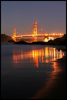 Golden Gate bridge at night from Baker Beach. San Francisco, California, USA