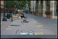 Woman sitting at a commemorative table in a downtown alley. San Jose, California, USA ( color)