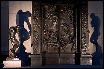 Rodin's monumental Gates of Hell at night. Stanford University, California, USA