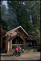 Couple sitting in front of park headquarters, afternoon. Big Basin Redwoods State Park,  California, USA ( color)