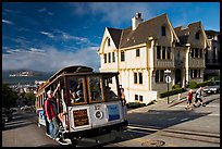 Cable car climbing, and Tudor house, late afternoon. San Francisco, California, USA ( color)