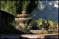 Fountain and cacti, Mission San Miguel Arcangel. California, USA