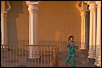 Indian girl running in the Sikh Gurdwara Temple, late afternoon. San Jose, California, USA ( color)