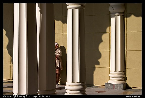 Woman and colonade, Sikh Gurdwara Temple. San Jose, California, USA (color)