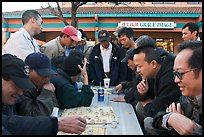 Vietnamese immigrants at a Chinese chess game. San Jose, California, USA ( color)