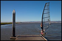 Windsurfer near deck, Palo Alto Baylands. Palo Alto,  California, USA (color)