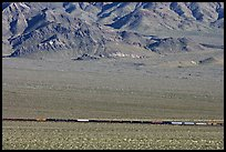Freight train in desert valley. Mojave National Preserve, California, USA