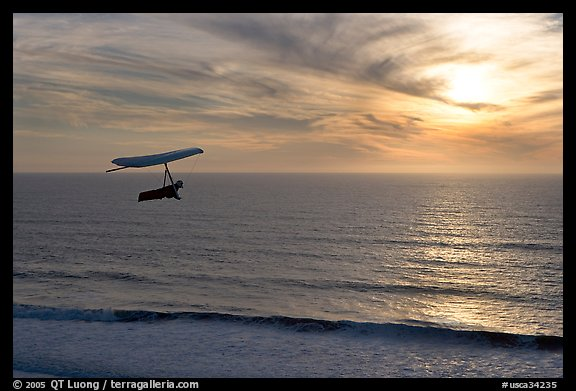 Hang gliding above the ocean at sunset,  Fort Funston. San Francisco, California, USA