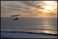 Hang gliding above the ocean at sunset,  Fort Funston. San Francisco, California, USA (color)