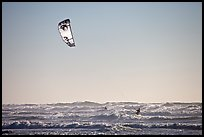Kitesurfer in powerful waves, afternoon. San Francisco, California, USA