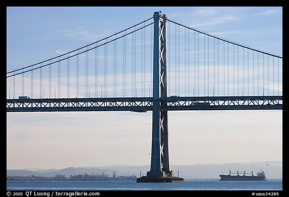 Traffic on Oakland Bay Bridge and tanker ship. San Francisco, California, USA (color)