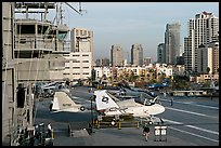 Flight control tower, aircraft, San Diego skyline, USS Midway aircraft carrier. San Diego, California, USA
