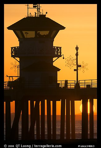 Lifeguard tower on Huntington Pier at sunset. Huntington Beach, Orange County, California, USA