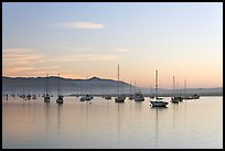 Yachts in calm Morro Bay harbor, sunset. Morro Bay, USA (color)