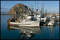 Fishing boats with reflections and Morro Rock, early morning. Morro Bay, USA ( color)