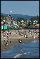 Children, beach, and boardwalk. Santa Cruz, California, USA
