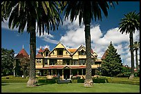 Palm trees and mansion facade. Winchester Mystery House, San Jose, California, USA ( color)