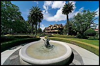 Wide view of fountain, gardens,  and mansion. Winchester Mystery House, San Jose, California, USA ( color)