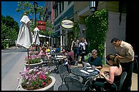 Lunch at streetside restaurant tables. Santana Row, San Jose, California, USA ( color)