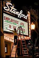 Woman changing movie title, Stanford Theatre. Palo Alto,  California, USA