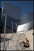 Women sunning on the steps of the entrance of the Walt Disney Concert Hall. Los Angeles, California, USA (color)