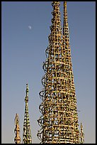 Simon Rodia Watts Towers and moon, late afternoon. Watts, Los Angeles, California, USA (color)
