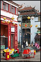Rides and buildings in Chinese style, Chinatown. Los Angeles, California, USA ( color)