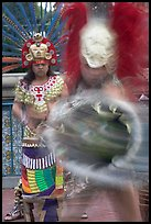 Aztec dancers in motion,  El Pueblo historic district. Los Angeles, California, USA ( color)