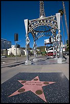 Star from the Hollywood walk of fame and gazebo with statues of actresses. Hollywood, Los Angeles, California, USA