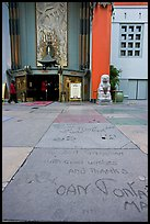 Handprints and footprints of actors and actresses in cement, Grauman theater forecourt. Hollywood, Los Angeles, California, USA (color)