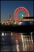 Ferris Wheel in motion at nightfall. Santa Monica, Los Angeles, California, USA
